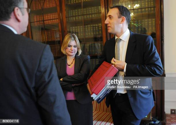 Justine Greening with Dan Rosen Field holding the new budget box minutes before leaving No11 Downing Street to pose for photographs for this year's...
