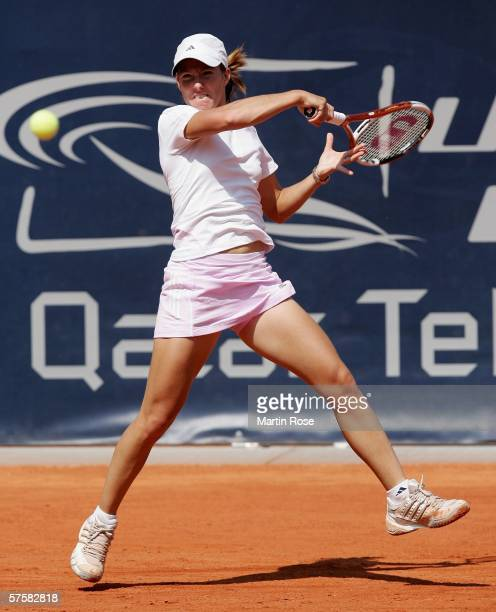 Justine Henin Hardenne of Belgium returns to Maria Kirilenko of Russia during the fourth day of the Womens Qatar Telecom German Open at the Rot Weiss...