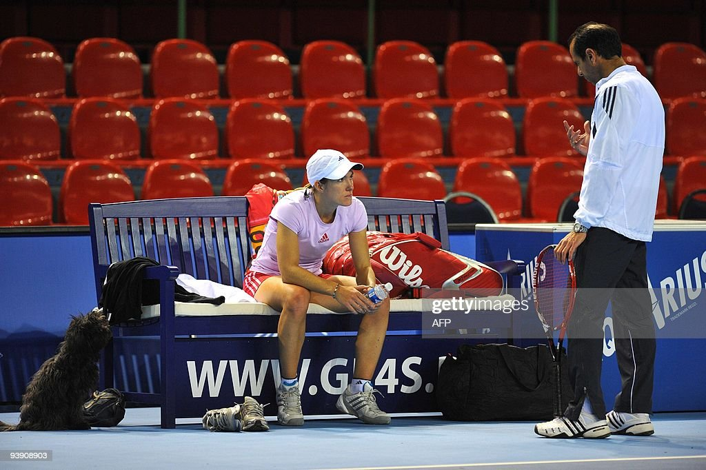 Justine Henin her dog Deuce and coach Carlos Rodriguez during a training session in Charleroi on December 4 2009 Henin will play tomorrow an...