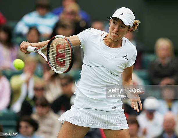 Justine Henin of Belgium hits a backhand during the Women's Singles second round match against Vera Dushevina of Russia during day three of the...