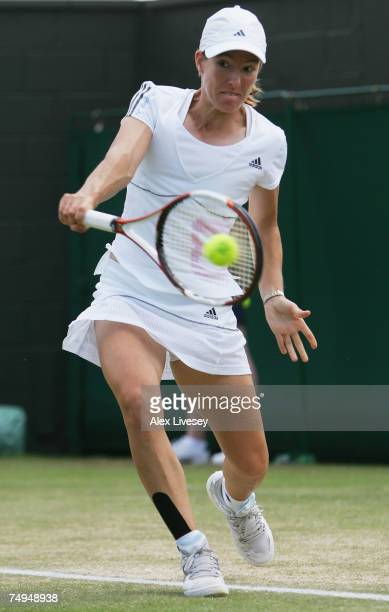 Justine Henin of Belgium hits a backhand during the Women's Singles third round match against Elena Vesnina of Russia during day five of the...