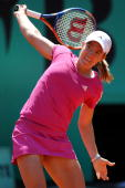 Justine Henin of Belgium plays a backhand during the women's singles second round match between Justine Henin of Belgium and Klara Zakopalova of...