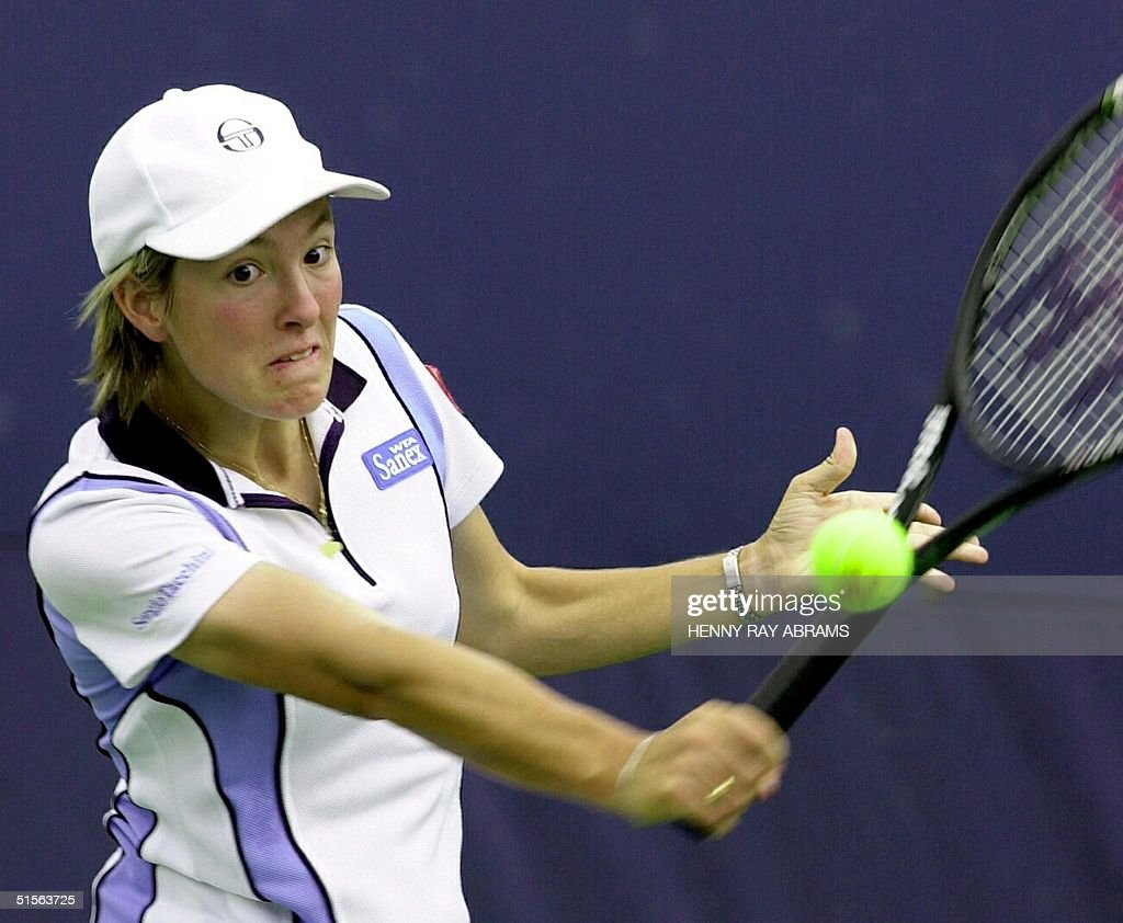 Justine Henin of Belgium returns a backhand to A