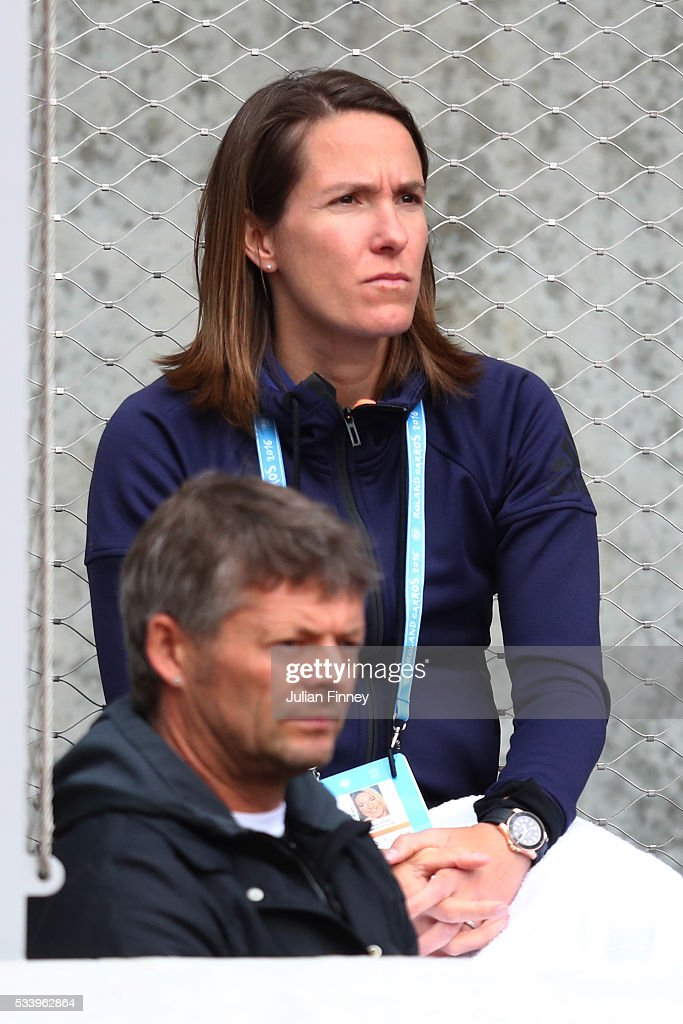Justine Henin watches the Women's Singles first round match between Elina Svitolina of Ukraine and Sorana Cirestea of Romania on day three of the 2016 French Open at Roland Garros on May 24, 2016 in Paris, France.