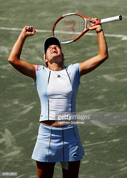 Justine HeninHardenne of Belgium celebrates her victory over Elena Dementieva of Russia during the final of the Family Circle Cup at Family Circle...