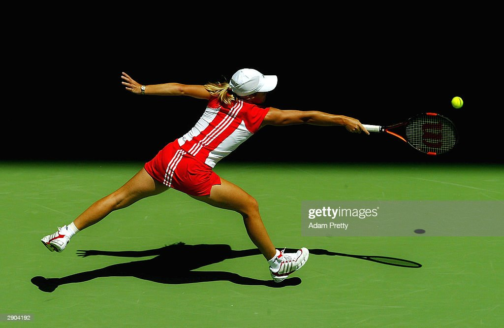 Justine HeninHardenne of Belgium hits a backhand against Lindsay Davenport of the USA during day nine of the Australian Open Grand Slam at Melbourne...