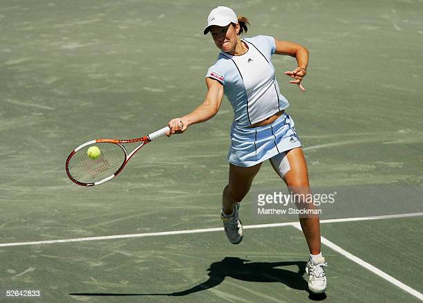 Justine HeninHardenne of Belgium hits a forehand against Elena Dementieva of Russia during the final of the Family Circle Cup at Family Circle...