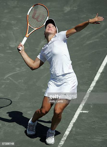 Justine HeninHardenne of Belgium hits a serve during her third round match against Karolina Sprem of Coatia on April 13 2006 during the third round...