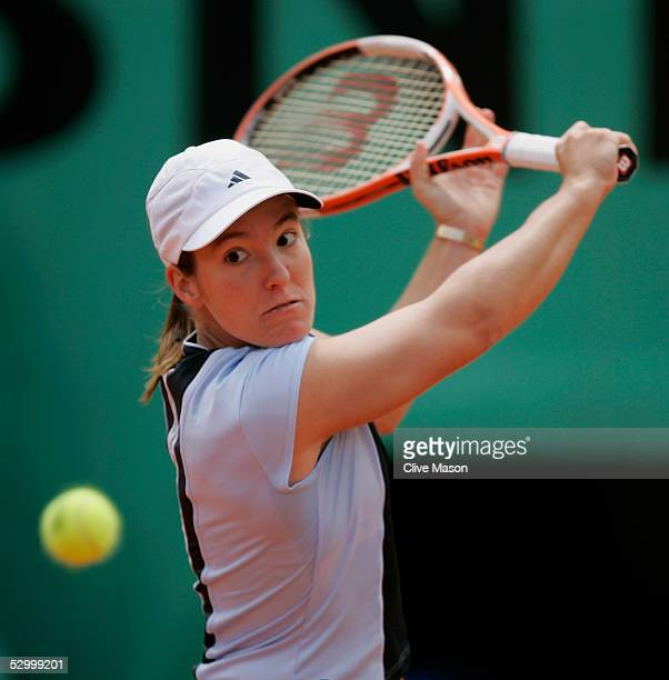 Justine HeninHardenne of Belgium in action during her fourth round match against Svetlana Kuznetsova of Russia during the eighth day of the French...