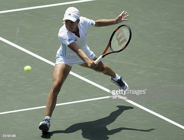 Justine HeninHardenne of Belgium lunges to hit a backhand against Elena Dementieva of Russia during the Acura Classic on July 31 2003 at the La Costa...