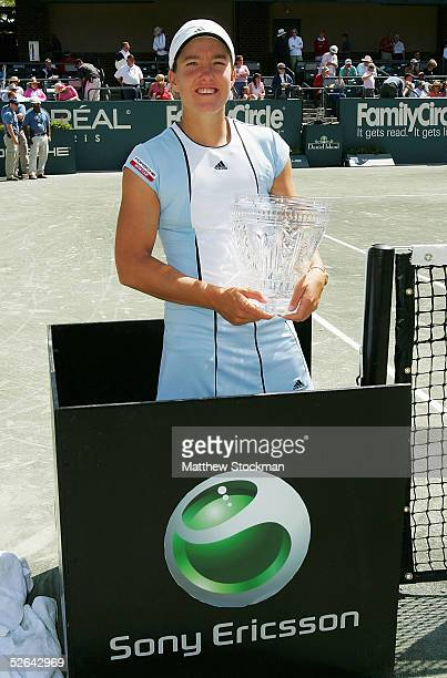 Justine HeninHardenne of Belgium poses with the winner's trophy after defeating Elena Dementieva of Russia during the final of the Family Circle Cup...
