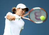 Justine HeninHardenne of Belgium returns a backhand to Jelena Jankovic of Serbia and Montenegro during the US Open at the USTA Billie Jean King...