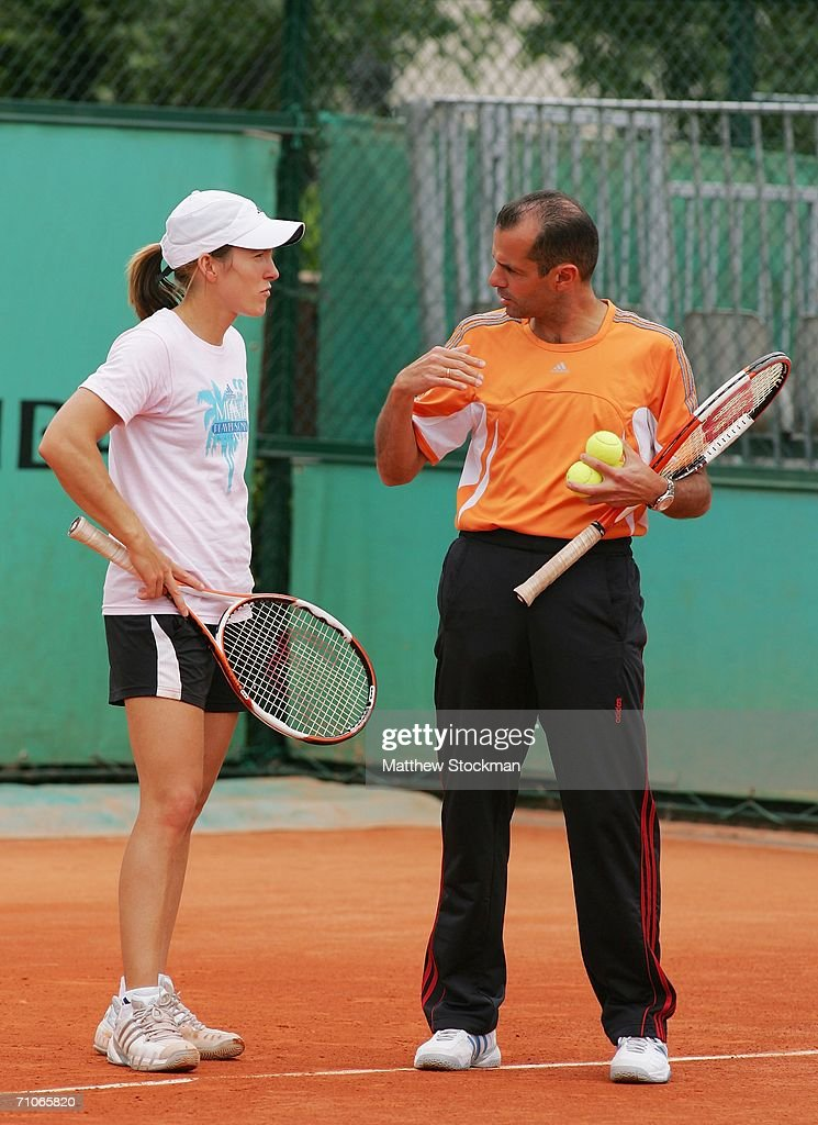 Justine HeninHardenne of Belgium talks to her coach Carlos Rodriguez during practice prior to the French Open at Roland Garros on May 27 2006 in...