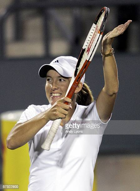 Justine HeninHardenne of Belgium waves to the crowd after her second round victory over Sybille Bammer of Austria on April 11 2006 during the Family...