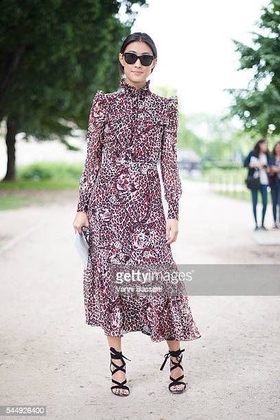 Justine Lee poses before the Giambattista Valli show at the Grand Palais during Paris Fashion Week Haute Couture FW 16/17 on July 4 2016 in Paris...