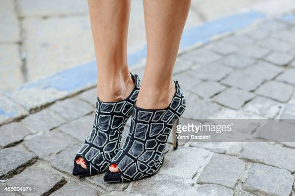 Justine Mattera poses wearing Byblos shoes on September 17 2014 in Milan Italy