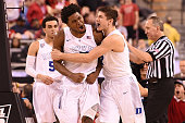 Justise Winslow and Grayson Allen of the Duke Blue Devils celebrate following a play against the Wisconsin Badgers during the NCAA Men's Final Four...