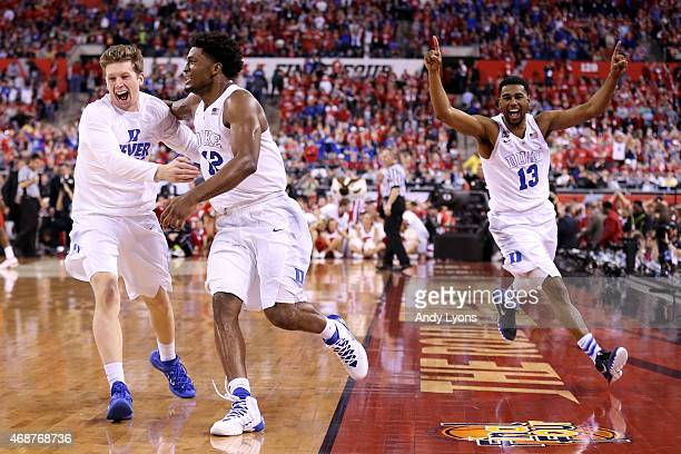 Justise Winslow and Matt Jones of the Duke Blue Devils celebrate with teammates after defeating the Wisconsin Badgers during the NCAA Men's Final...