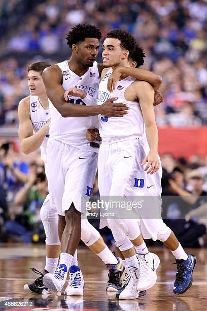 Justise Winslow and Tyus Jones of the Duke Blue Devils react after a play in the first half against the Michigan State Spartans during the NCAA Men's...