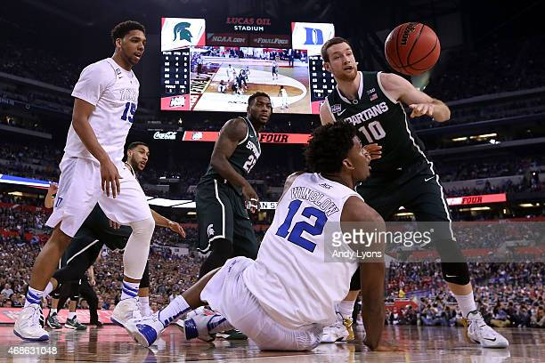 Justise Winslow of the Duke Blue Devils and Matt Costello of the Michigan State Spartans go for a loose ball during the NCAA Men's Final Four...
