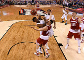 Justise Winslow of the Duke Blue Devils drives to the basket against Bronson Koenig of the Wisconsin Badgers in the second half during the NCAA Men's...