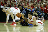 Justise Winslow of the Duke Blue Devils fights Duje Dukan of the Wisconsin Badgers for a loose ball during the first half at Kohl Center on December...