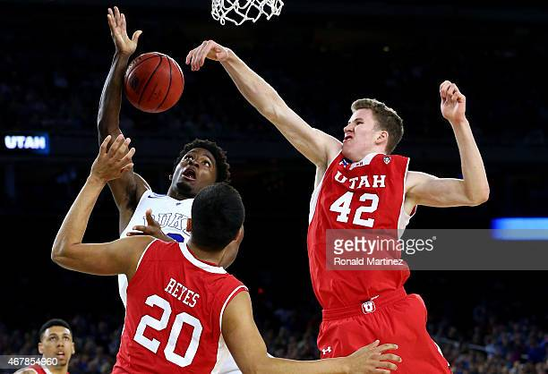 Justise Winslow of the Duke Blue Devils goes to the basket as Jakob Poeltl and Chris Reyes of the Utah Utes defend during a South Regional Semifinal...