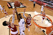 Justise Winslow of the Duke Blue Devils goes up with the ball against Frank Kaminsky and Duje Dukan of the Wisconsin Badgers in the first half during...