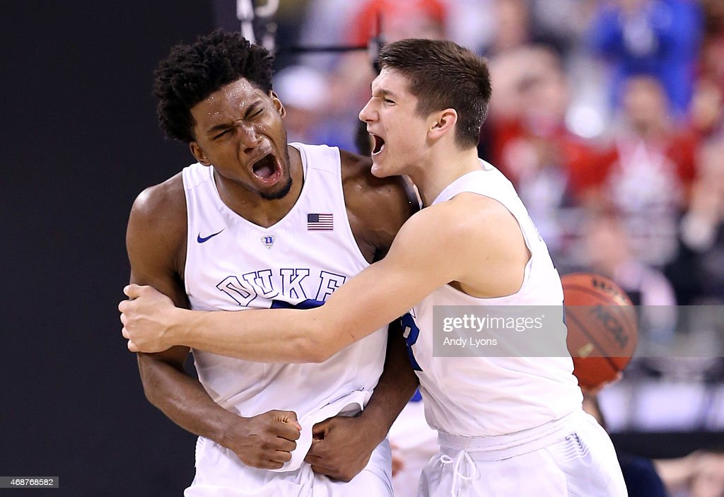 Justise Winslow of the Duke Blue Devils reacts with Grayson Allen after a play late in the second half against the Wisconsin Badgers during the NCAA...