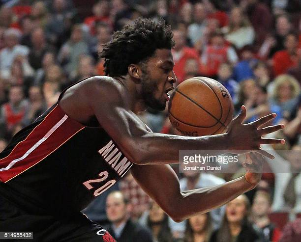 Justise Winslow of the Miami Heat grabs a rebound against the Chicago Bulls at the United Center on March 11 2016 in Chicago Illinois The Heat...
