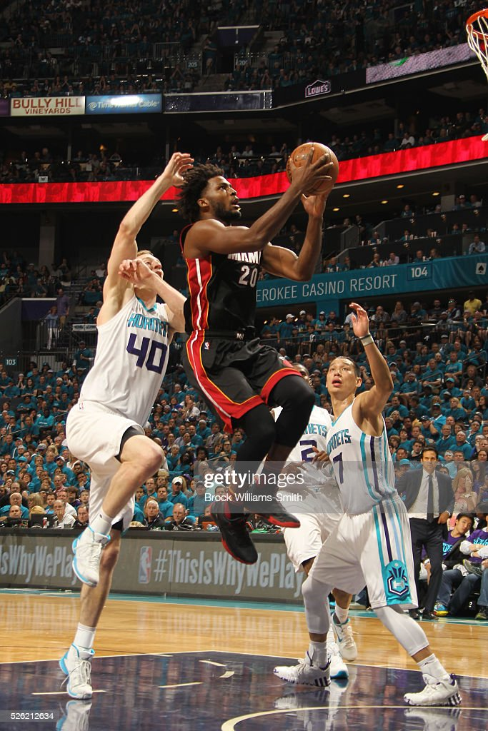 <a gi-track='captionPersonalityLinkClicked' href=/galleries/search?phrase=Justise+Winslow&family=editorial&specificpeople=11268130 ng-click='$event.stopPropagation()'>Justise Winslow</a> #20 of the Miami Heat shoots against <a gi-track='captionPersonalityLinkClicked' href=/galleries/search?phrase=Cody+Zeller&family=editorial&specificpeople=7621233 ng-click='$event.stopPropagation()'>Cody Zeller</a> #40 and the Charlotte Hornets in Game Six of the Eastern Conference Quarterfinals during the 2016 NBA Playoffs on April 29, 2016 at Time Warner Cable Arena in Charlotte, North Carolina.