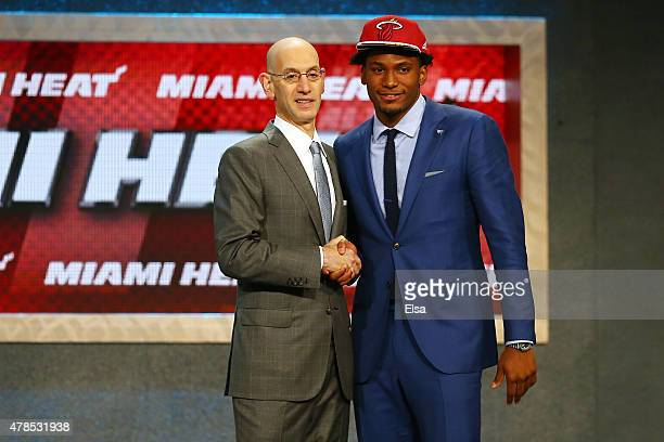 Justise Winslow poses with Commissioner Adam Silver after being selected tenth overall by the Miami Heat in the First Round of the 2015 NBA Draft at...