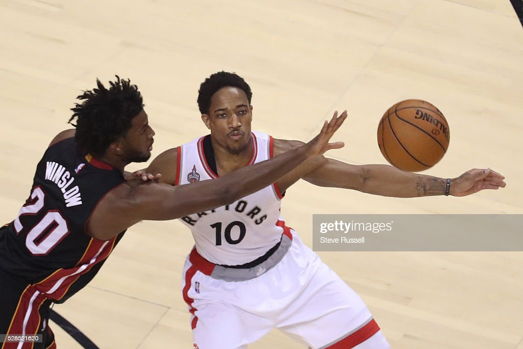 Justise Winslow tries to swat the ball away from Toronto Raptors guard DeMar DeRozan as the Toronto Raptors play the Miami Heat in game two of their Eastern Conference Semifinal at the Air Canada Centre in Toronto. May 5, 2016.
