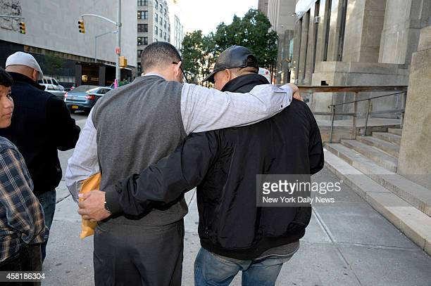 Justo Santos is embraced by his brother as they leave Manhattan Supreme Court Joselyn Martinez's father Jose Martinez was allegedly killed by Justo...