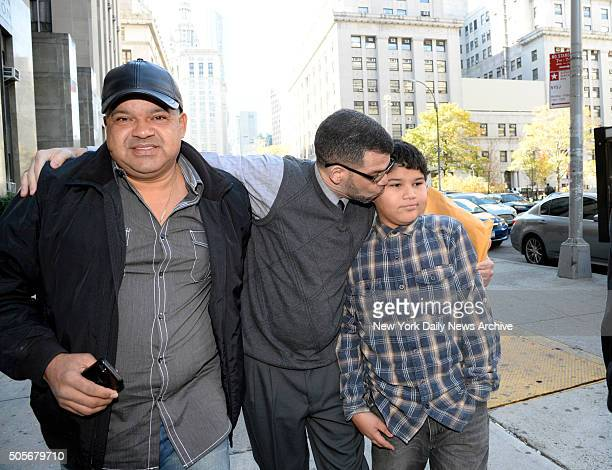 Justo Santos kisses his son Rafael as they and his brother leave Manhattan Supreme Court on Thursday October 30 2014 Joselyn Martinez's father Jose...