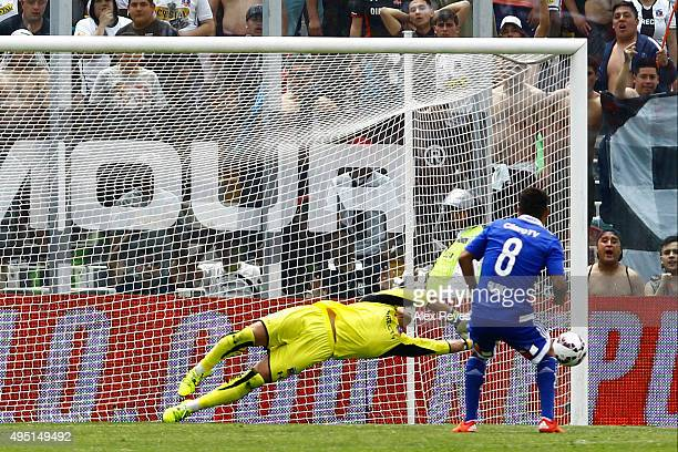 Justo Villar of Colo Colo saves the penalty shot by Patricio Rubio of U de Chile during a match between Colo Colo and U de Chile as part of...