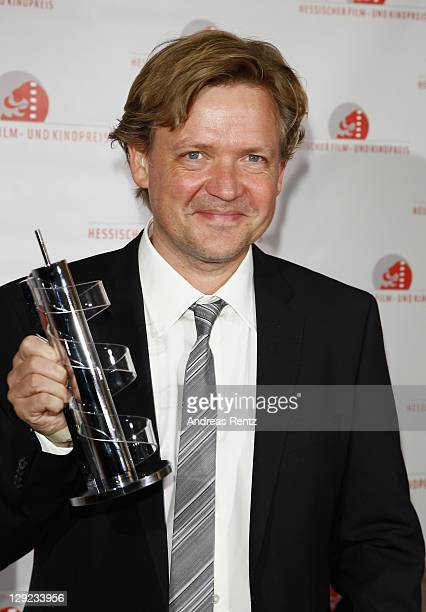 Justus von Dohnanyi poses with his award during the 22nd Hesse Movie Award at Alte Oper on October 14 2011 in Frankfurt am Main Germany