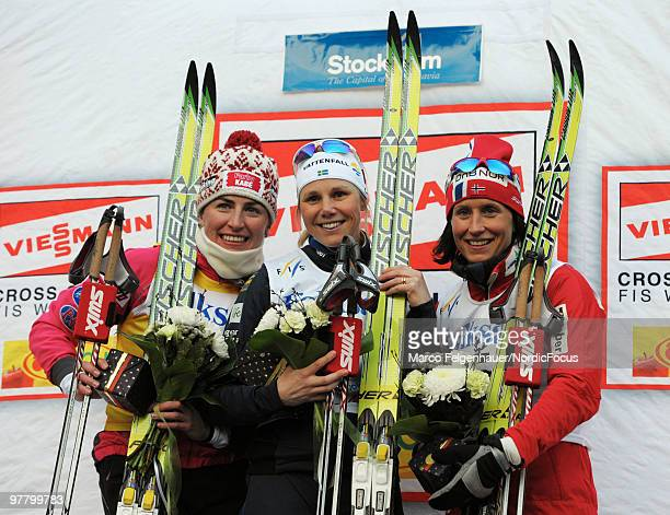 Justyna Kowalczyk of Poland Anna Olsson of Sweden and Marit Bjoergen of Norway celebrate after the individual sprint Cross Country Skiing during the...