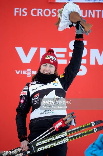 Justyna Kowalczyk of Poland celebrates after winning the Women's 9km Classic Pursuit at the FIS Cross Country World Cup event at DKB Ski Arena on...