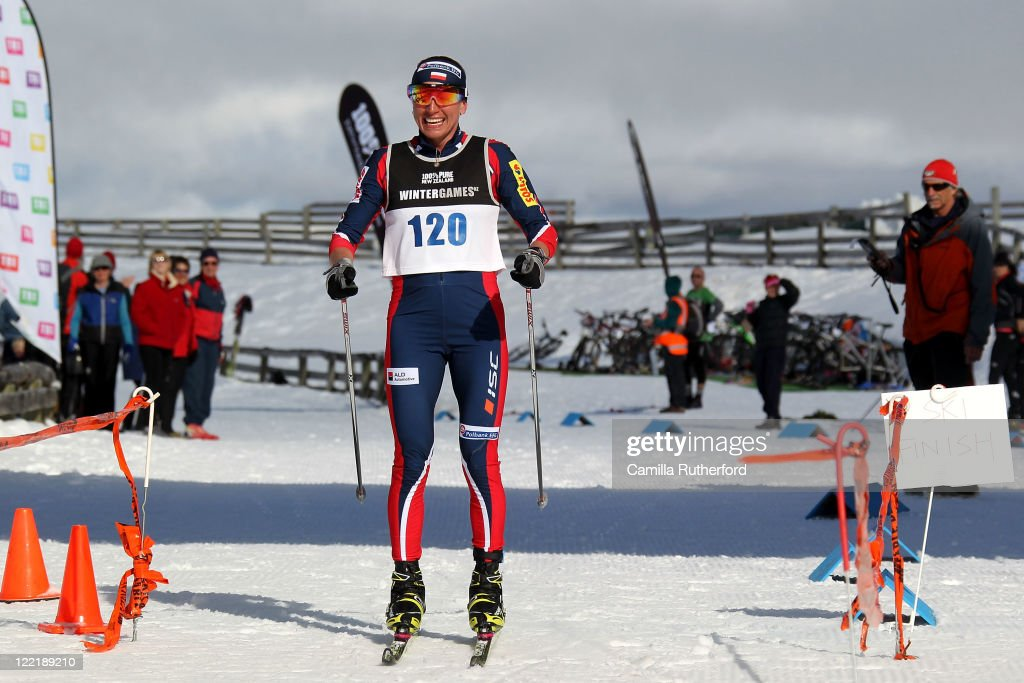 Justyna Kowalczyk of Poland celebrates crossing the line after the Winter Triathlon during day 15 of the Winter Games NZ at Snow Farm on August 27, 2011 in Wanaka, New Zealand.