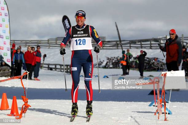 Justyna Kowalczyk of Poland celebrates crossing the line after the Winter Triathlon during day 15 of the Winter Games NZ at Snow Farm on August 27...