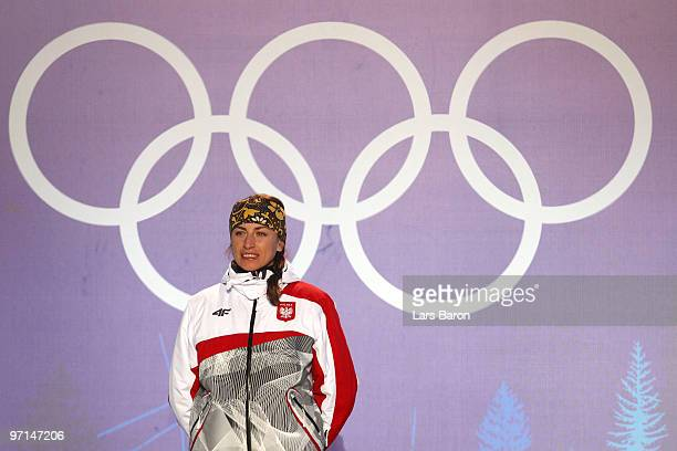 Justyna Kowalczyk of Poland celebrates Gold during the medal ceremony for the Ladies Cross Country 30 km Mass Start Classic during the medal ceremony...