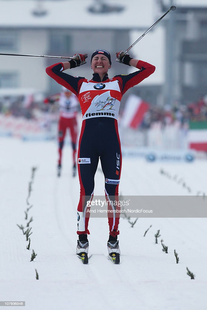 Justyna Kowalczyk of Poland celebrates her victory during the mass women for the FIS Cross Country World Cup Tour de Ski on January 8, 2011 in Val di Fiemme, Italy.