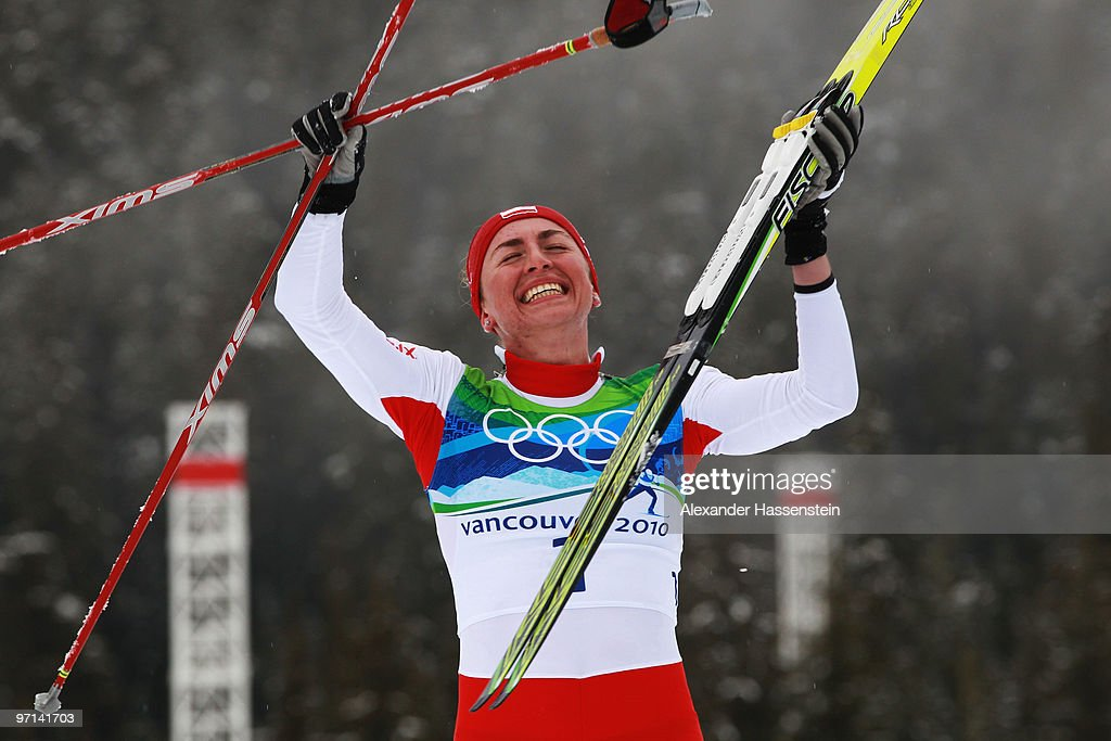 Justyna Kowalczyk of Poland celebrates winning the gold medal in the ladies' 30 km mass start cross-country skiing classic on day 16 of the 2010 Vancouver Winter Olympics at Whistler Olympic Park Cross-Country Stadium on February 27, 2010 in Whistler, Canada.