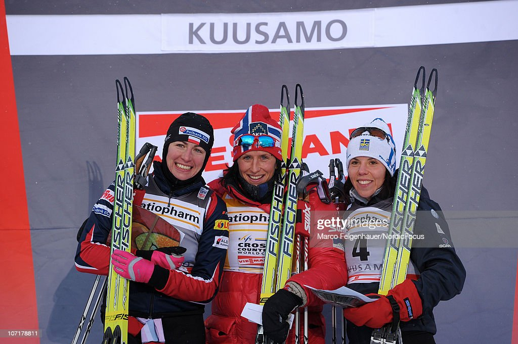 Justyna Kowalczyk of Poland, Marit Bjoergen of Norway and Charlotte Kalla of Sweden pose on the podium after the women 10km free handicap start during the FIS World Cup Cross Country Skiing on November 28, 2010, in Kuusamo, Finland.