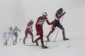 Justyna Kowalczyk of Poland Therese Johaug of Norway and Marit Bjoergen of Norway compete in the Ladies Cross Country 15km Pursuit race during the...