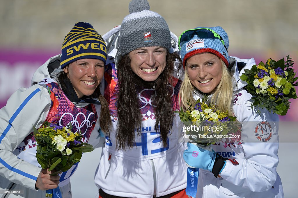 Justyna Kowalczyk of Poland wins gold medal, Charlotte Kalla of Sweden wins silver medal, Therese Johaug of Norway wins bronze medal during the Cross-Country Women's 10km Classic at the Laura Cross-country Ski & Biathlon Center on February 13, 2014 in Sochi, Russia.
