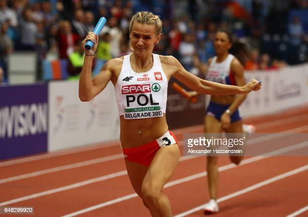 Justyna Swiety of Poland crosses the finish line to win gold for her team in the Women's 4x400 metres relay final on day three of the 2017 European...