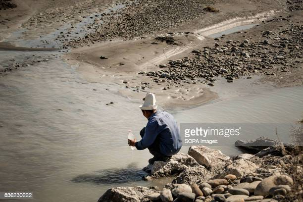Jusubali Jamylbaev a shepherd fills a bottle with water from River Soh in Aktorpak Kyrgyzstan In rural areas people face serious problems with water...