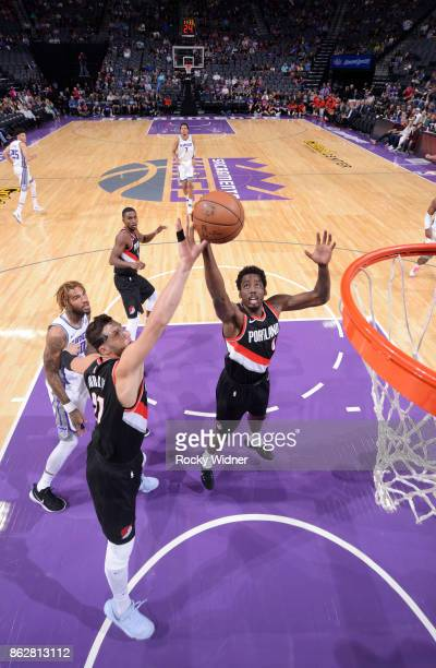 Jusuf Nurkic and AlFaroug Aminu of the Portland Trail Blazers rebound against the Sacramento Kings on October 9 2017 at Golden 1 Center in Sacramento...